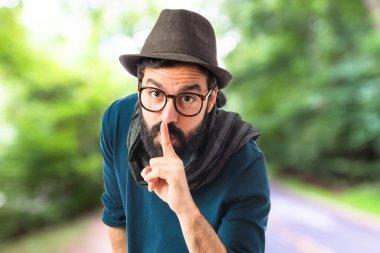 Artist making silence gesture