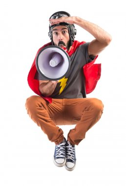 Superhero shouting by megaphone