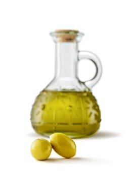 Olives and bottle of virgin olive oil