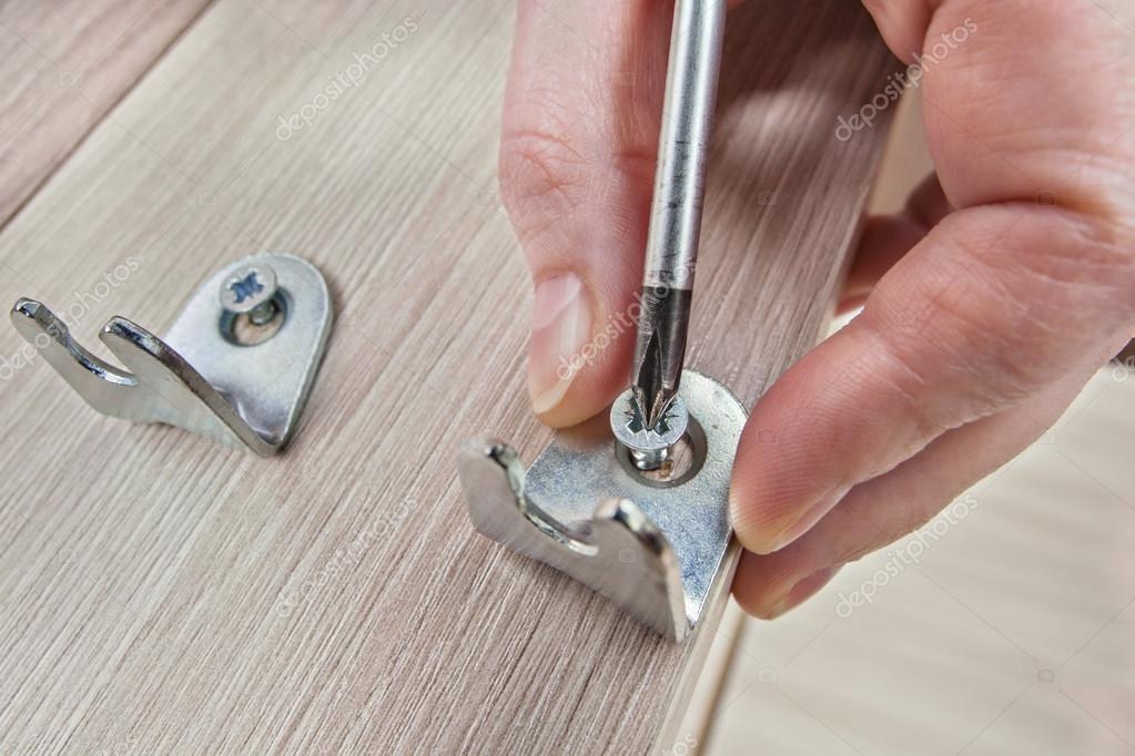 Assembling Furniture Bracket Screwing Screw Using Phillips Head Screwdriver Close Up Stock