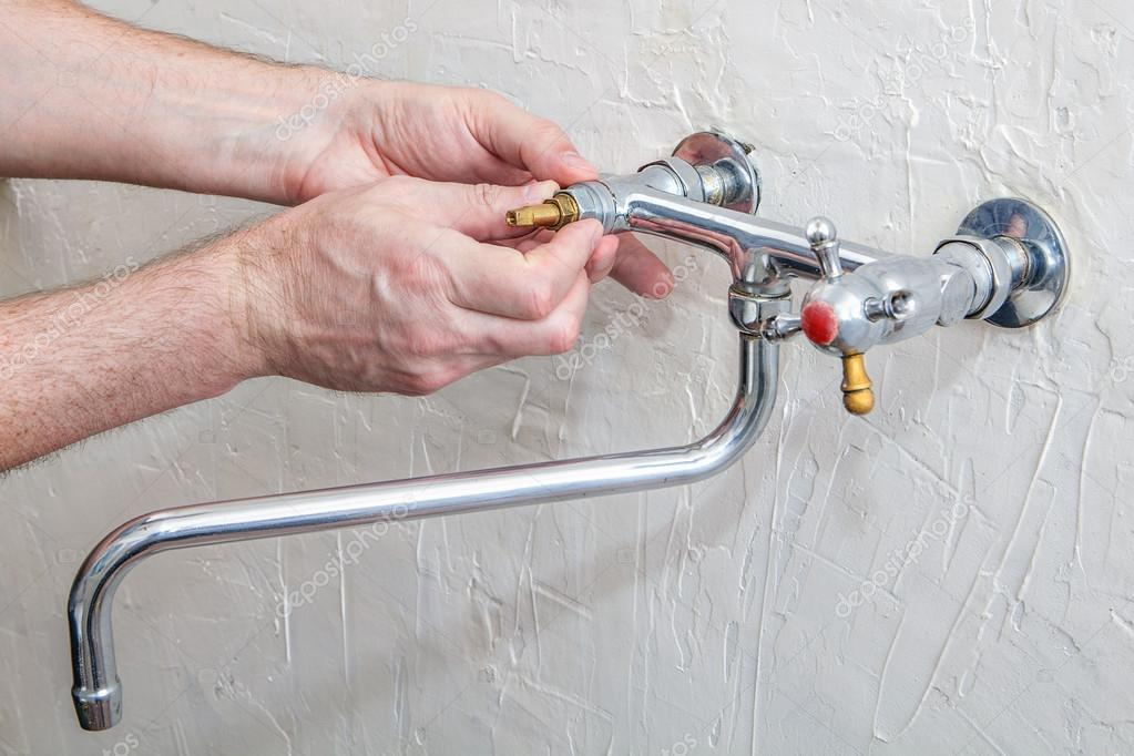 Two handle kitchen faucet repair, plumber hands replacement tap ...
