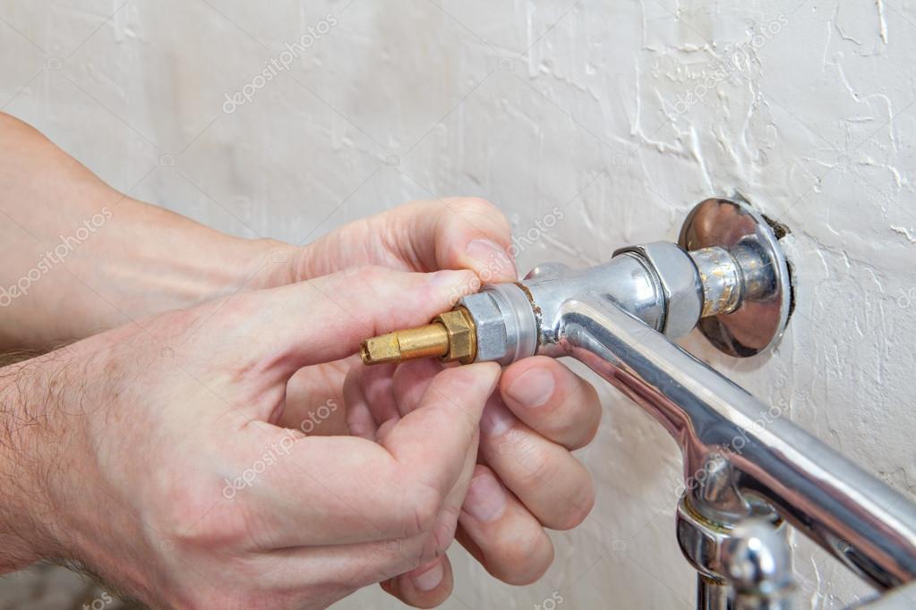 Double handle kitchen faucet repair, plumber hands replacing valve ...
