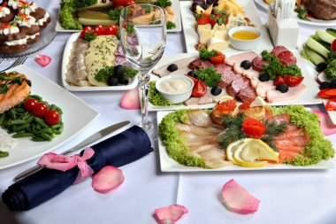 Beautifully decorated table, with meat and fish specialties.