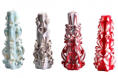 Set of four colorful wax candles handmade carved,  on white.