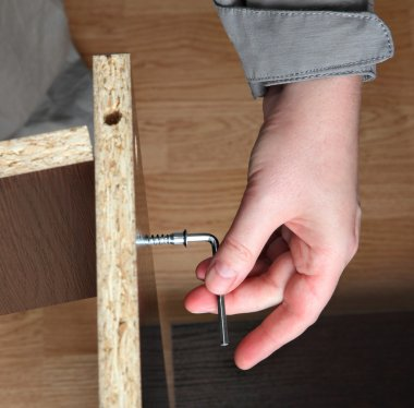 Furniture assembly, wood screw screwed manually using allen key.