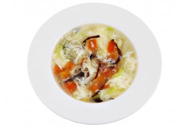 Chinese tomato, egg whites and mushrooms soup,  isolated on white.