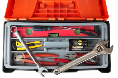 Orange black plastic toolbox with set of old hand tools.