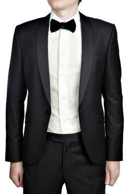 Dark gray mens evening dress, blazer, white shirt, bow tie.