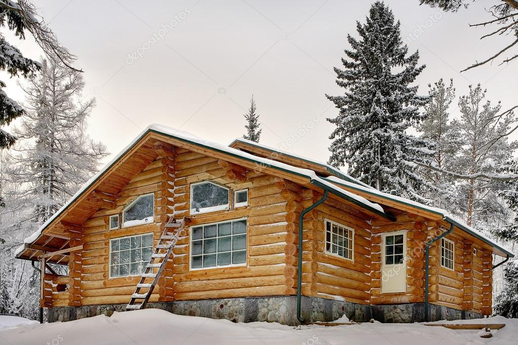 Modern wooden handmade log Vacation Home during winter.