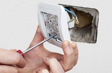 Replace wall light switch, close-up.