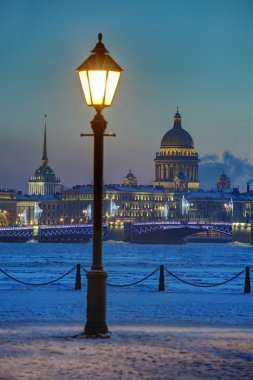 Street light on embankment Neva River, winter evening, Saint-Petersburg, Russia.