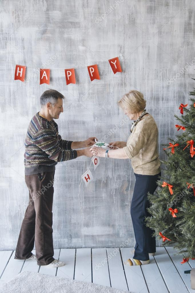 Two Senior People Decorating The House