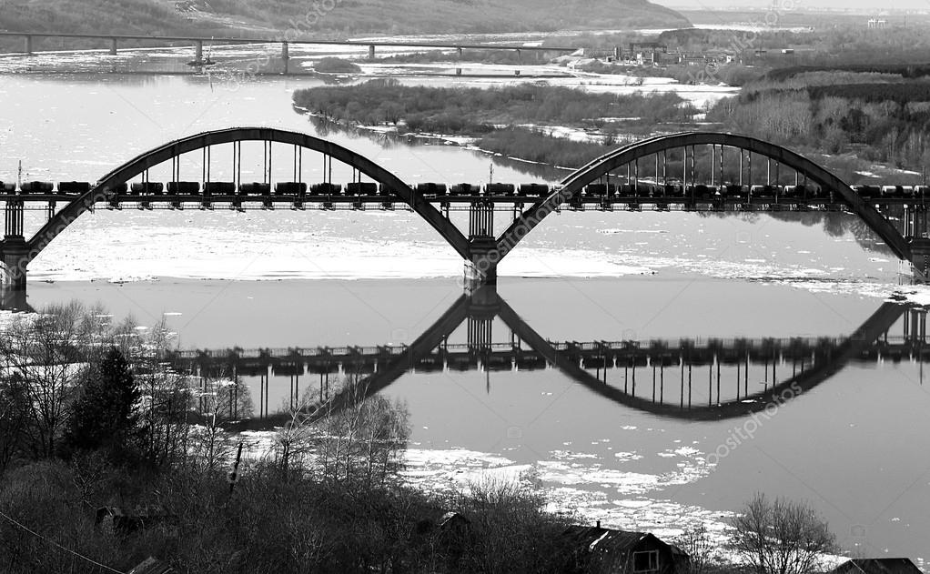 The railway bridge and its reflexion in the river, create illusion - an infinity sign. Symbolizing infinite pumping out of minerals.