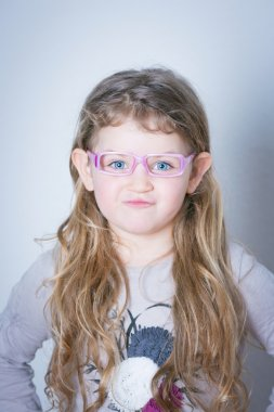 mischievous little girl with glasses
