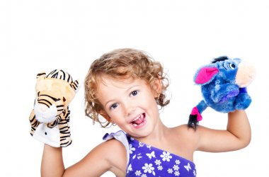 Little girl with plush puppets