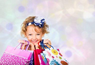 Joyful girl with bags of shopping