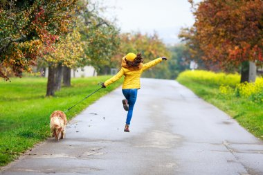 funny girl running with dog friend