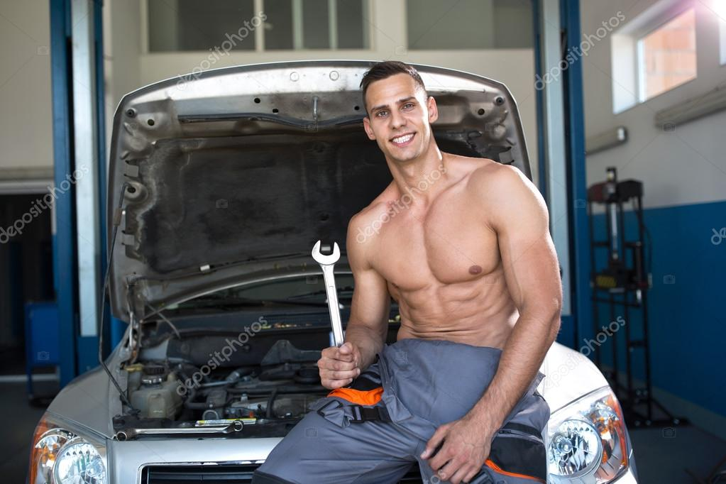 Handsome Muscular Mechanic With A Tool Stock Photo