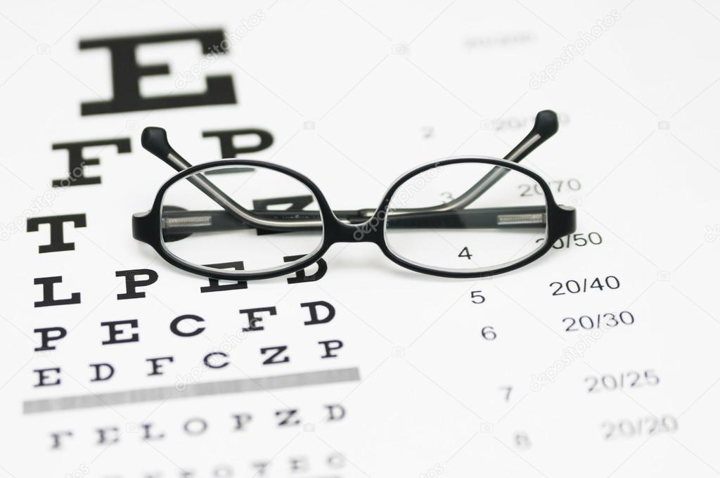 Glasses on eye chart — Stock Photo © stalnyk #59430615