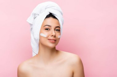 Beautiful woman with towel on hair and cosmetic cream on face isolated on pink stock vector