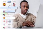 mladý africký americký tlumočník ve sluchátkách psaní na notebooku na rozmazaném popředí, ilustrace rozhraní překladatelské aplikace