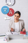happy interpreter pointing with hand near notebook and laptop, icons with arrows illustration