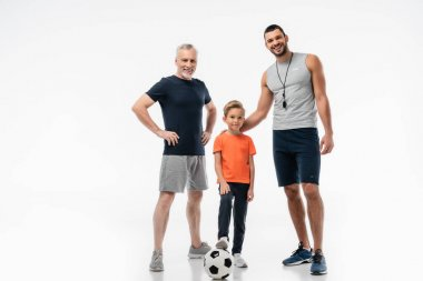 Happy father and grandpa near smiling boy stepping on soccer ball on white stock vector
