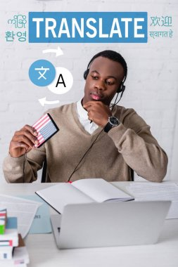 African american interpreter holding digital translator, icons with arrows near words in different languages. Translation: