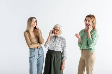 Three generation of women talking on smartphones isolated on white stock vector