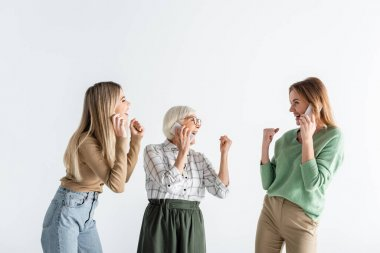 Three generation of excited women talking on smartphones isolated on white stock vector