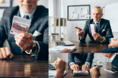 Collage of businessman holding euro banknotes and pointing at colleague with papers on blurred foreground