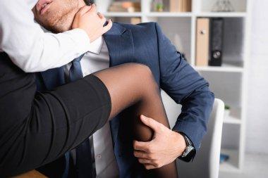 Passionate businessman hugging leg of secretary, blurred foreground stock vector