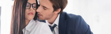 Passionate businessman kissing seductive secretary in eyeglasses, banner stock vector