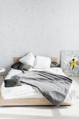 Grey blanket and pillows on bed at home stock vector