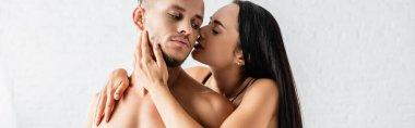Brunette woman kissing seductive man at home, banner stock vector