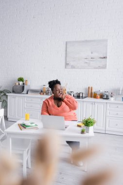 Amazed african american plus size freelancer working from home stock vector