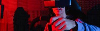 Focused teenage boy gaming on car racing simulator, banner stock vector