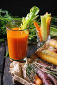 Fotografie Colorful carrots and juice