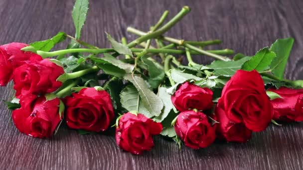 Valentines days arrangements with red roses and red gift box over gray background