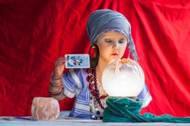 little child plays to be a fortune teller