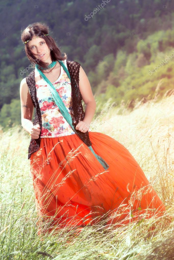 Hippie girl in a meadow windy