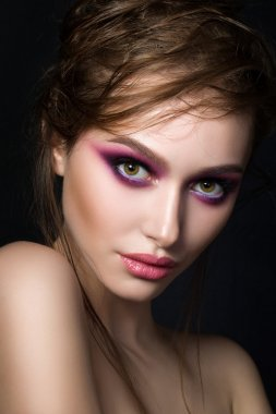Closeup portrait of young beautiful woman with bright pink smoke