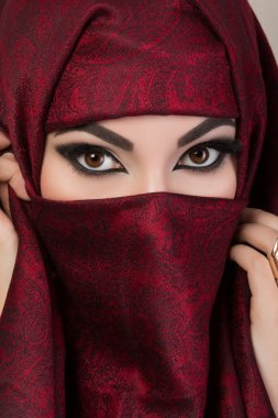 Portrait of beautiful arabian girl hiding her face