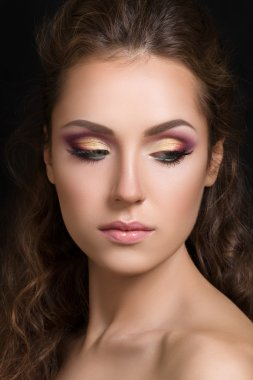 Close-up beauty portrait of young pretty brunette