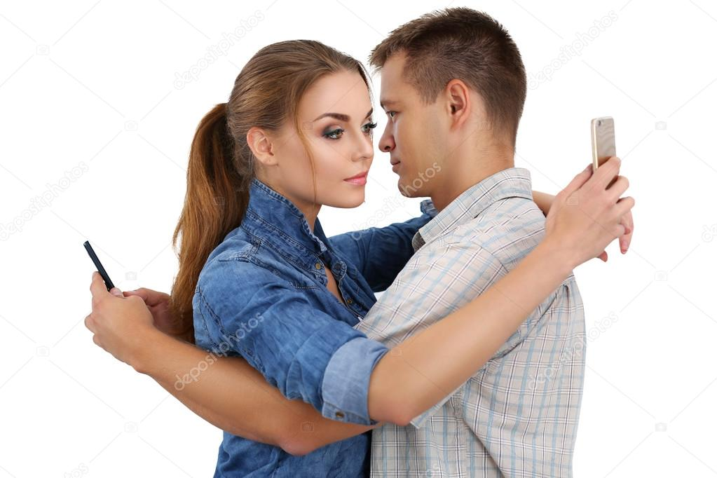Portrait of young couple standing together and ignoring each oth
