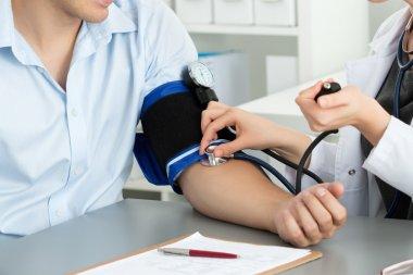 Female medicine doctor hands measuring blood pressure