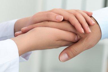 Female medicine doctor reassuring her patient