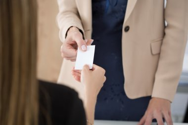 Businesswoman giving her businesscard to her partner