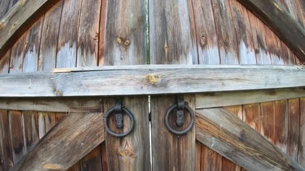 Big old wooden gate . Medieval wall of the monastery.