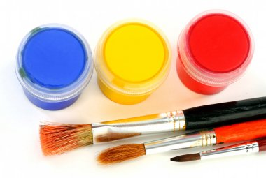 Multicolor children paints with brush on white background